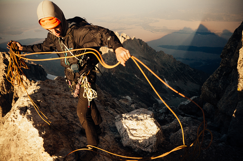 Tad McCrea readying for a dark descent as the penumbra of the Grand Teton tatoos the valley below. Tetons, WY